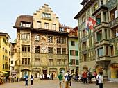 People at facade of Hirschenplatz in Lucerne, Switzerland