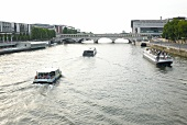 View of Ferry boats and arch bridge on Seine river, Paris, France