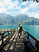 Tourists walking on jetty in Lake Lucerne, Alps, Lucerne, Switzerland