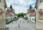 Man walking in Courtyard of Sprudelhof, Bad Nauheim, Hessen, Germany