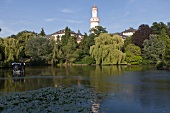 View of lake and white tower, Castle park, Bad Homburg, Germany