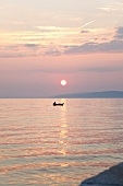 View of sunset and boat in sea, Gradac, Croatia