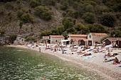 Tourists on beach at Kvarner bay, Croatia