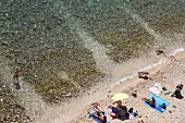 Kvarner Bay and people relaxing on beach, Croatia