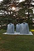 Mao jacket sculptures in Castle Park, Bad Homburg, Hesse, Germany