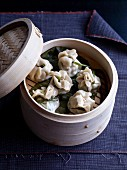 Steamed dumplings filled with salmon (China)