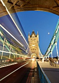 Light trails of speedy vehicles on Tower Bridge, Southwark, London, England, blurred