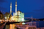 Illuminated Mecidiye mosque with waterfront at night, Bosphorus, Turkey