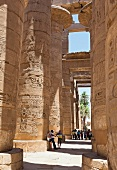 People standing at the Great Hypostyle Hall of Temple Karnak near Luxor, Egypt