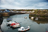 View of boats moored at harbour of Portpatrick, Scotland