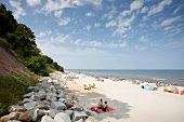 Tourists relaxing on beach of Rewal in Poland