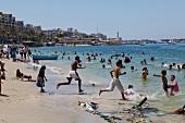 People enjoying on beach in Alexandria, Egypt