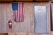 American flag hanging on construction shed in Ground Zero, New York, USA
