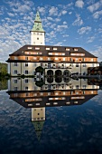 Hotel Schloss Elmau reflected in water, Upper Bavaria, Germany