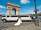 Wedding couple standing near car in Arc de Triomphe, Place Charles de Gaulle, Paris