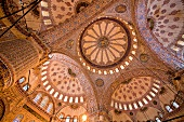 Upward view of blue mosque domes inside Sultan Ahmed Mosque, Istanbul