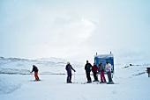 Skiers waiting before Piste Map in Hemsedal ski, Norway