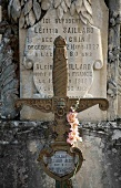 Close-up of grave stone and cross in cemetery, France