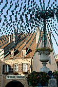 View of streets of Place de la Liberte in Arbois, Franche-Comte, France