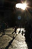 People at Plaza Mayor, Madrid, Spain, backlit