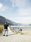 Man at Reuss delta with Lake and Alps mountain overlooking Fluelen, Lucerne, Switzerland