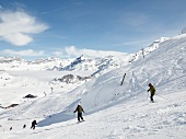 Skiers at the Joch Pass ski slope, Uri Alps, Titlis, Engelberg, Switzerland