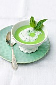 Cream of pea soup with mint foam
