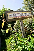 Close-up of Konrade organic beekeeping nameplate in Putbus, Rugen