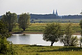 View of Rhine river at Wesel-Bislich and Cathedral of Xanten, Niederrhein, Germany