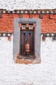 Prayer wheels at Jampey Lhakhang temple, Bhutan