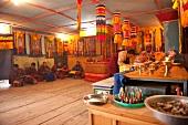 People praying at prayer hall of school, Ura valley, Bhutan