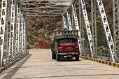 Truck passing through a bridge at Tashigang, Bhutan