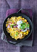 Fried wheat with sweetcorn and red onions