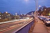 Light trails and cars on old bridge at Saarbrucken, Saarland, Germany