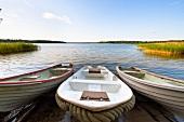 Three boats moored in Galindia Mazurski Eden, Warmia Masuria, Poland