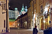 View of illuminated Wawel castle and old town in Krakow, Poland, blurred motion