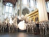 Woman photographing bridal statues in Nieuwe Kerk Church, Amsterdam, Netherlands
