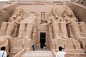 Tourist at entrance of Abu Simbel temple in Egypt