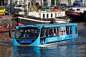 People travelling in floating bus in Oudeschans, Amsterdam, Netherlands