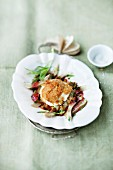 Artichoke salad with melted goat's cheese and redcurrant vinaigrette
