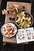 Chestnut salad with apples and porcini mushroom salad with diced tomatoes