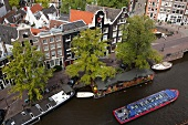 View of Prinsengracht, Old Town, and ferryboat from Westerkerk, Amsterdam, Netherlands