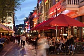 People at restaurants and bars in evening, Leidseplein, Amsterdam, Netherlands