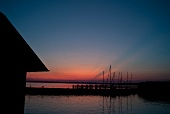 View of Chieminger Bay at dusk in Chieming, Chiemsee, Bavaria, Germany