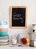 The phrase 'Good Morning' written on a blackboard in a student kitchen