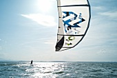 View of man doing kite surfing, Chiemgau, Bavaria, Germany