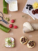 Ingredients for open sandwiches with quark and for cheese rolls with olives