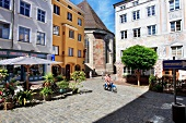 View of Parish Church of St. Jacob and street at Wasserburg am Inn, Schustergasse, Germany