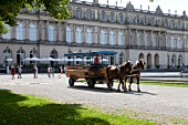 Horse carriage in front of Herrenchiemsee New Castle in Bavaria, Germany