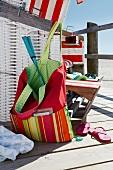 Colourful bag and chair at beach
